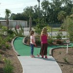 Playing putt putt. There are no shady areas so I do not recommend taking kids in the summer!