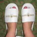 Hotel slippers in bedroom