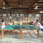Kids enjoying playing ping pong