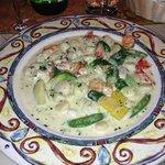 Lobster, shrimp, scollops and spring veggies in a lemon cream sauce.