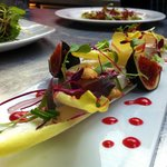 Fig, goats cheese and chicory salad, candied almonds and raspberry vinaigarette