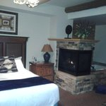 one bedroom cabin with two person jacuzzi tub and fireplace. view from living room door.