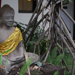 Buddha in the garden, next to our door