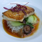 Pan seared Opah over bok choy, roasted shiitake mushrooms, & rice noodles, with a ginger lemongr