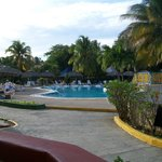 Looking across the pool at the main pool bar (El Dorado); Lobby to the left on the path