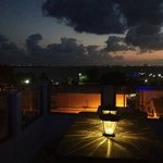 Rooftop at night with Cancun in distance
