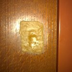 hole in door fixed with wood puddy