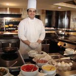 This amazing chef makes great omelets the way you want it. Best of all he gives service with a s