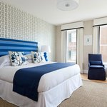 Nantucket hotel guestrooms feature custom drapes and sitting areas.