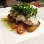 Pan seared monkfish, toasted garlic toast. fresh arugula