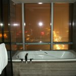 bath tub with city view behind