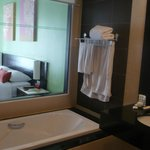 See through bathroom and king size bed