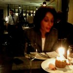 Blowing out the candles on birthday cake inside Narikala Hill Restuarant Tbilisi