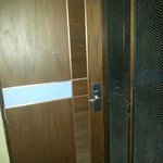 Noisy wooden doors. Nothing around edges of doors to keep doors from closing quietly.