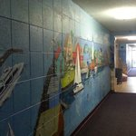hallway. murals used to hide the cinder block construction