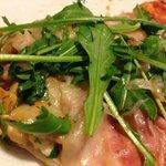 pizza Riki con rucola pancetta coppata e porcini