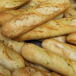 Bread sticks slathered in butter & Spices