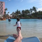 The Beach Tower pool and our toddler playing happily.  Note the zero-entry depth...