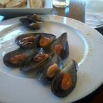 Half way through eating mussels with lemon and oil.