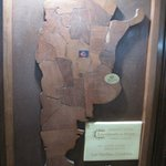 A cool wooden map of Argentina in the breakfast dining area.