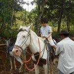 Alfonso helping saddle up