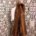 Room amenities include (a slightly kitch) animal-print robes to snuggle up in