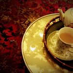 Tea is served in a range of vintage and antique teapots, cups and saucers, and commemorative spo