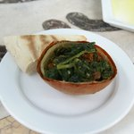 baked onion skin with delicious cooked spinach