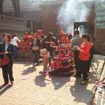 Worshipers lighting incense
