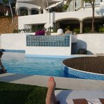 By the pool, all relaxed, loving it!