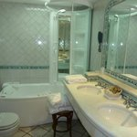 bathroom with jacuzzi tub and shower