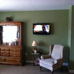 View from beds, flat panel TV on wall along with dresser