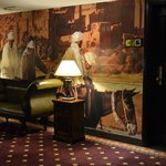 Life-size murals in hallways