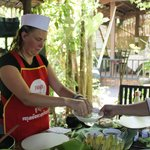 Chef is assisting residnent how to prepare and cook Khmer Food
