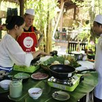 Staff are showing the resident to prepare and cook at Khmer Dining Cuisine Restaurant