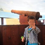 Kid with a cannon behind