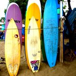 Friendly locals renting surfboards and selling drinks on the beach in front lane way from the Vi