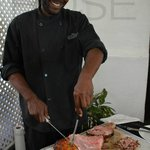 Local ham carved by one handsome Bajan with a smile!