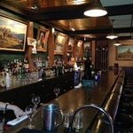 Bar is classic with western oil paintings, strong drinks