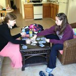 The girls playing cards in the living room of Room 12.