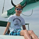 Son enjoying the day and the many hats aboard!