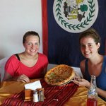 my friend and I with our favorite pizza (half pineapple, half green peppers)