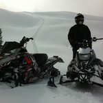 Untouched powder sledding with Golden Snowmobile Rentals and Tours