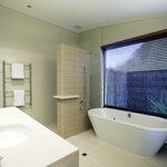 Villa bathrooms featuring deep, indulgent bath tubs