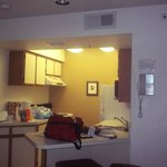 kitchen area with stove top, oven, microwave, fridge, toaster, coffeemaker