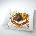Filet Mignon with Summer Squash, Tomato Jus, and Cheve & Roasted Garlic Souffle