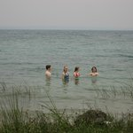 Kids swimming in lago Peten Itza