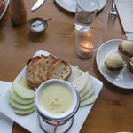 Fondue with crostini and fruit slices