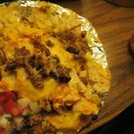 Nachos; notice the spoon full of meat and dried cheese