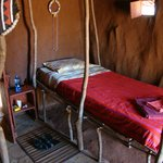 Single bed built of sturdy, locally sourced wood from our ranch.